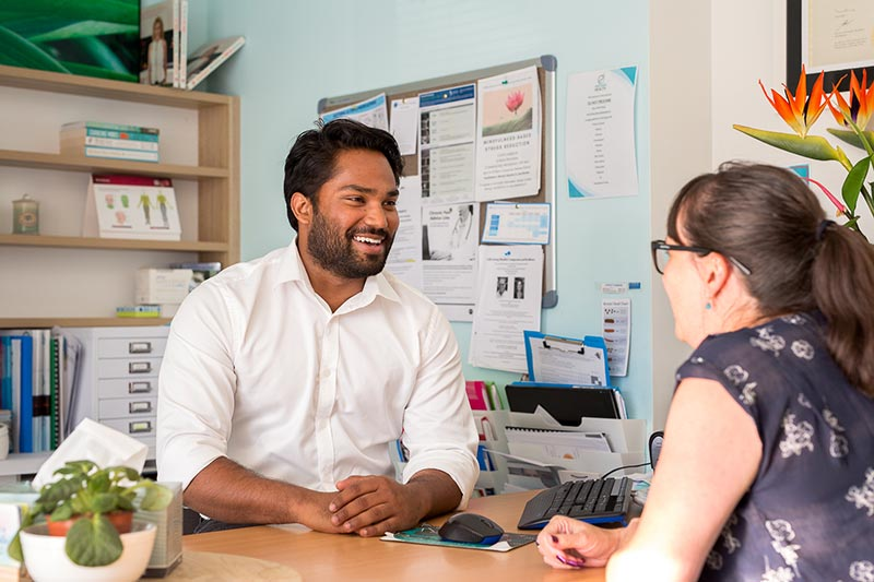 Dr Anand Pawar, GP at Northside Health consulting a woman patient at her visit in Coffs Harbour