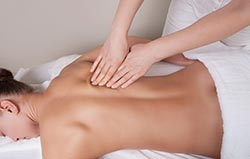 A massage therapist at work at Northside Health, Coffs Harbour